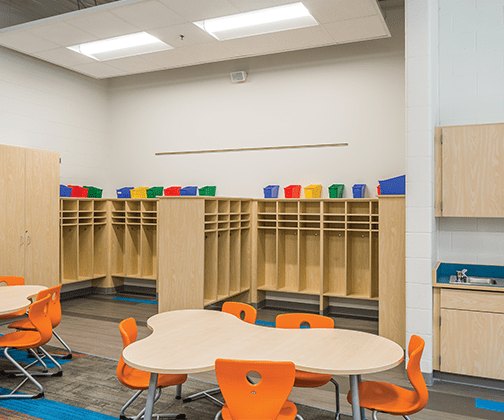 Image of a colorful classroom with k-12 casework examples