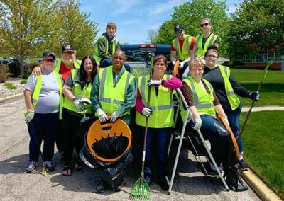Case Systems & BOSTONtec® employees gather for a picture after Midland Adopt-a-Street efforts.
