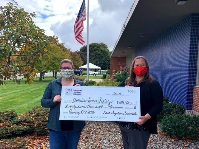 Employee Shari Franklin presents donation check to  local American Cancer Society Relay For Life® representative Trisha Jackson.